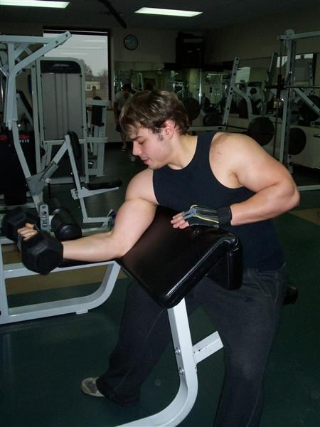 A young man lifting weights.