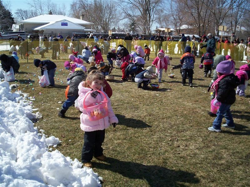 A field of children hunting for Easter eggs.