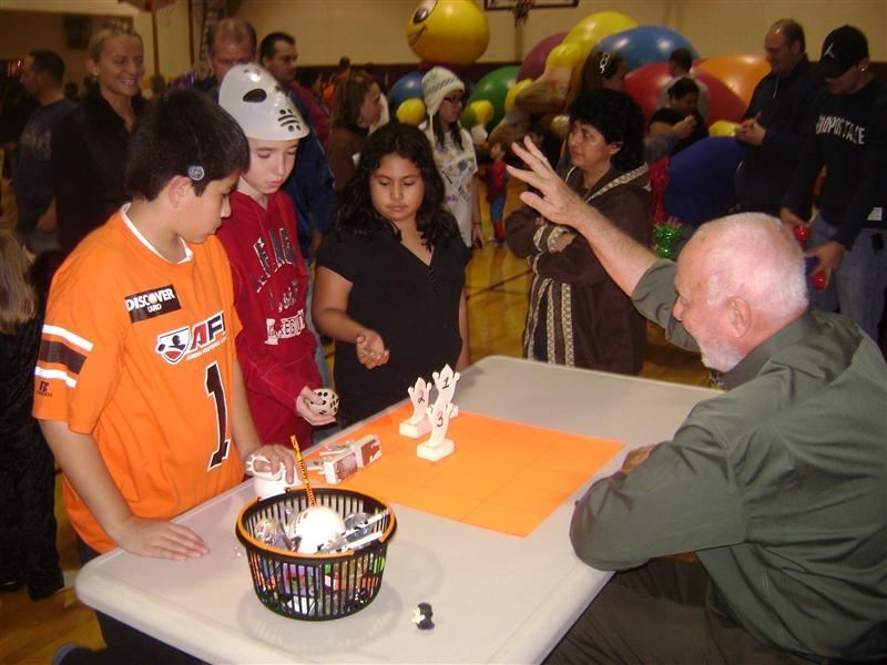 A group of people around a table playing a game.