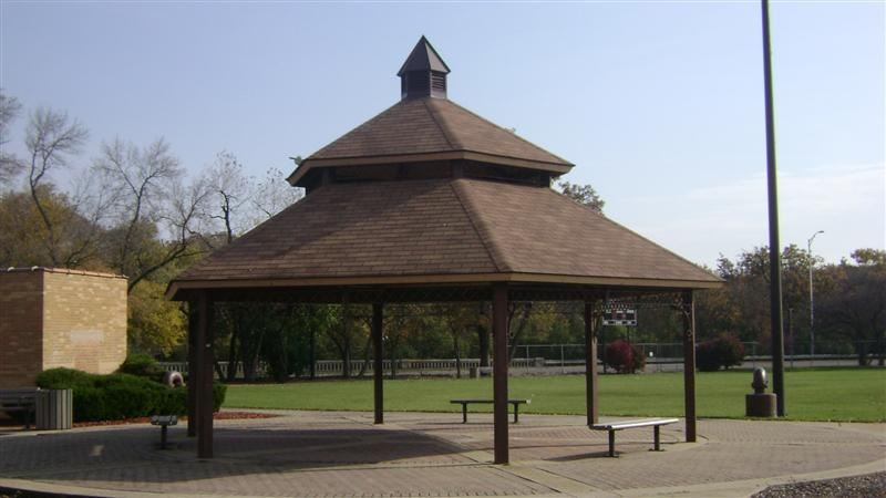 A neat, brown gazebo.