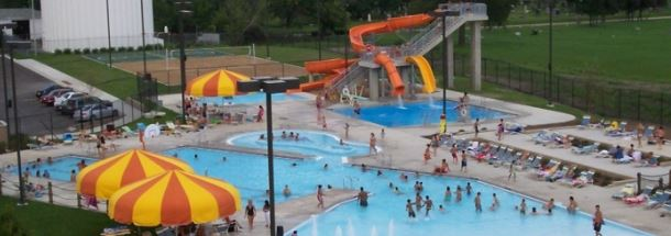 Overhead view of a pool and waterslide.