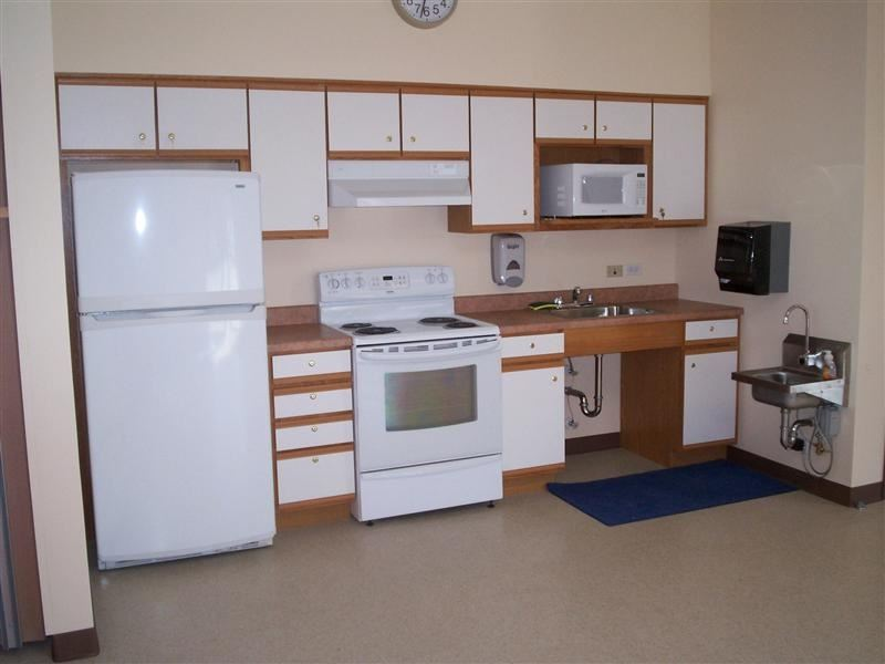 A furnished white kitchen.