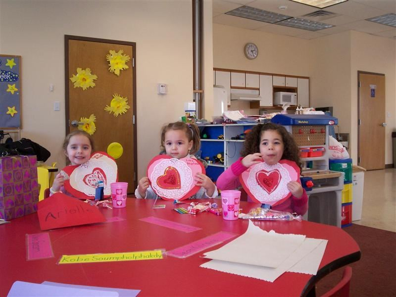 Children making Valentine's Day cards.