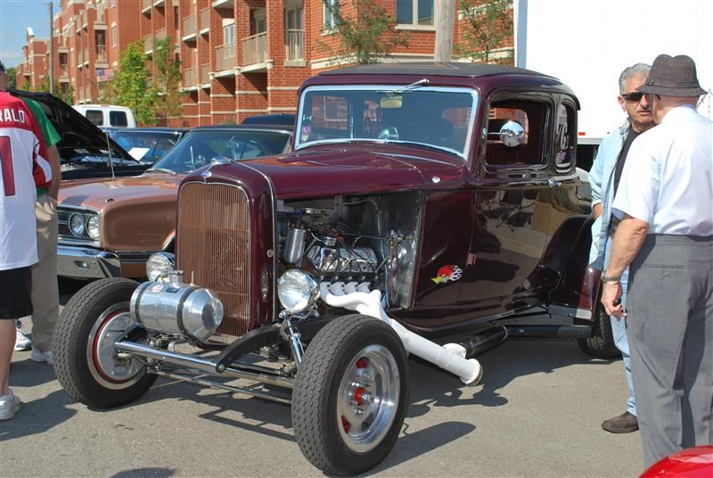 A burgundy hot rod car.