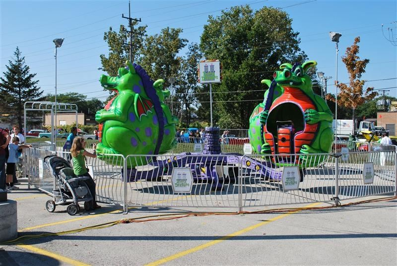 A carnival ride with green dragons.
